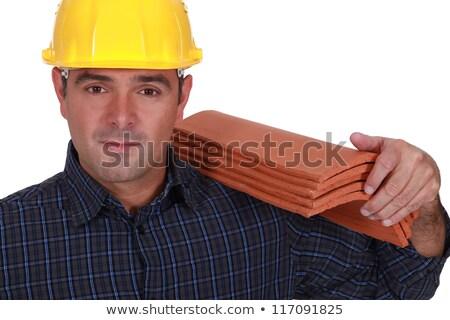 Tradesman carrying shingles Stock photo © photography33
