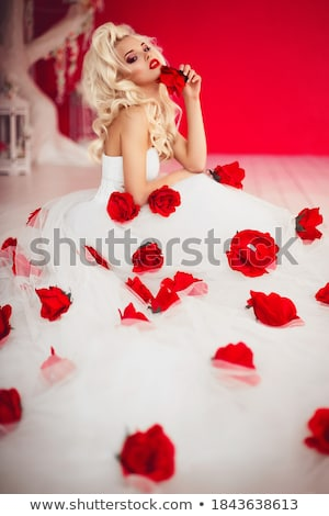 Young gorgeous dreamy woman lying in red dress Stock photo © gromovataya
