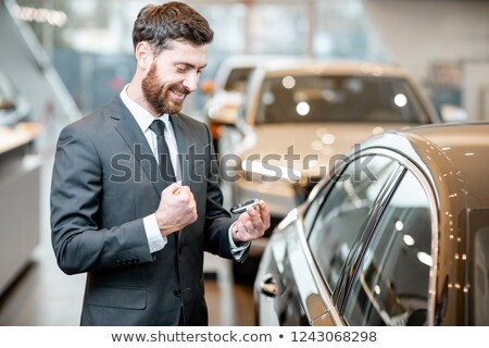 businessman holding a key stock photo © photography33