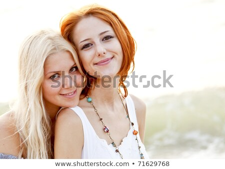 Two girlfriends in woman's paradise stock photo © konradbak