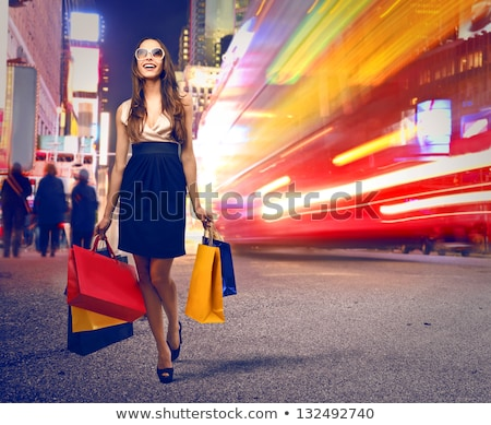 Laughing woman with colourful shopping bags Stock photo © Farina6000