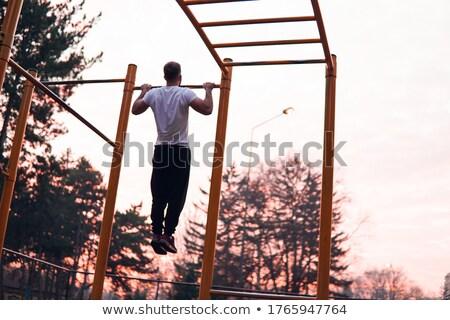 man · barbell · jonge · man · bank · druk - stockfoto © dacasdo