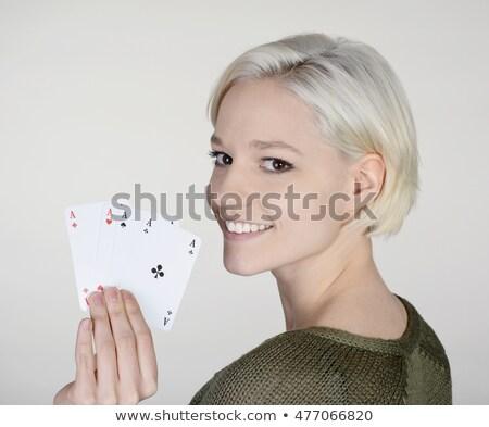 Fiatal nő tart négy ászok fiatal tinédzser Stock fotó © photography33