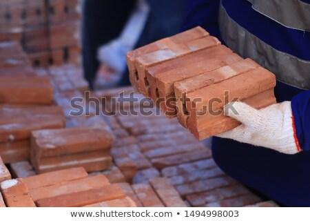 mano · ladrillo · cemento · edificio · pared · construcción - foto stock © photography33