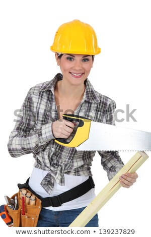 cute female carpenter using handsaw stock photo © photography33