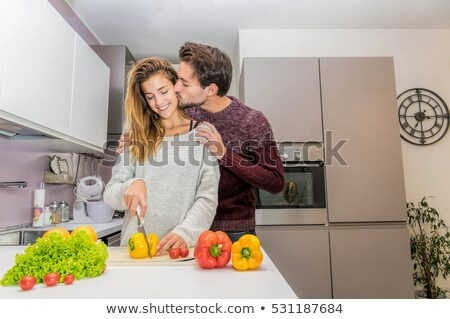 Beautiful young fresh modern couple hug on white stock photo © lunamarina
