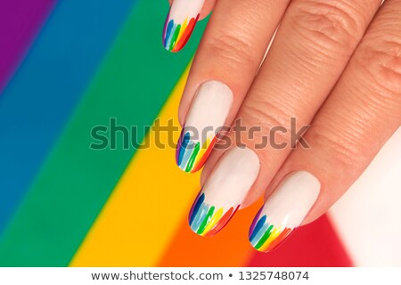 Rainbow clous manucure sept couleur vernis à ongles Photo stock © RuslanOmega