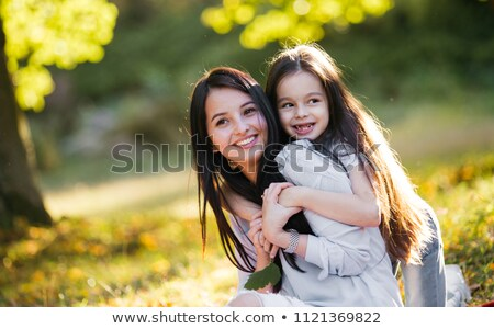 portrait of a beautiful hispanic happy mother with smiling baby stock photo © dacasdo