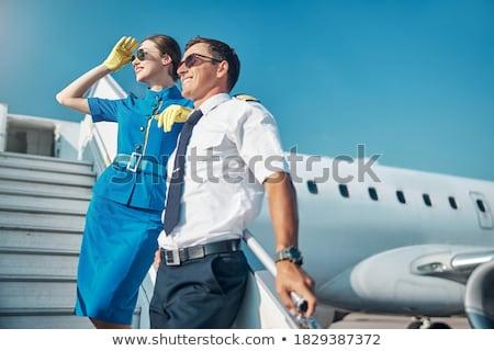 スチュワーデス 実例 若い女性 荷物 青 飛行機 ストックフォト © UrchenkoJulia