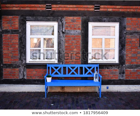 old wooden bench near stone wall Stock photo © Mikko
