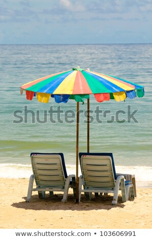 Napernyő kanapé színes homok tengerpart égbolt Stock fotó © meinzahn