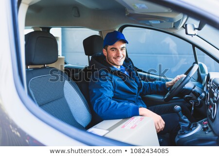 Courier man driving car delivering postal package Stock photo © CandyboxPhoto