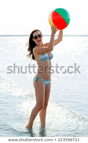 bella · pallone · da · spiaggia · donna · sorridente · occhiali · da · sole - foto d'archivio © stockyimages