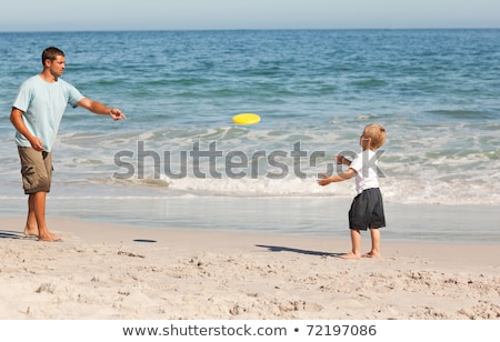 boy playing frisbee on beach stock photo © monkey_business