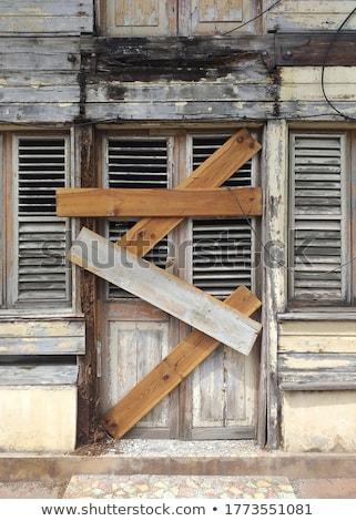 elöl · homlokzat · öreg · elhagyatott · épület · szellemváros - stock fotó © taigi