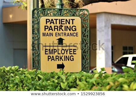 従業員 駐車場 道路標識 道路 赤 立って ストックフォト © jeffbanke
