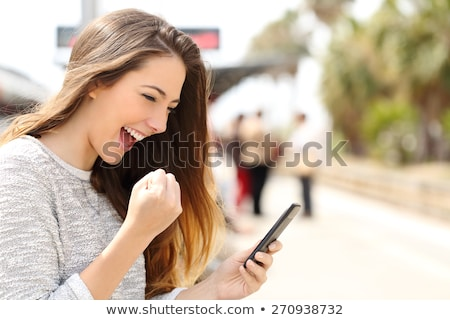 Young Beautiful Woman Using her Smart Phone Outdoor Stock photo © maxpro