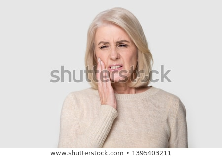 woman with a toothache holding head Stock photo © Pavlyuk