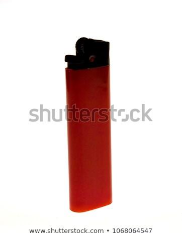 red cigarette lighter Stock photo © PetrMalyshev