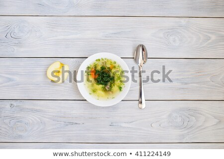 Half An Apple With Grated Carrot On White Plate Stock photo © Cipariss