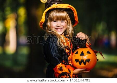 Little girl bruxa traje vassoura seis doce Foto stock © brittenham