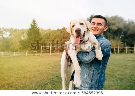 Stock fotó: Férfi · tart · kutya · alacsony · kulcs · portré