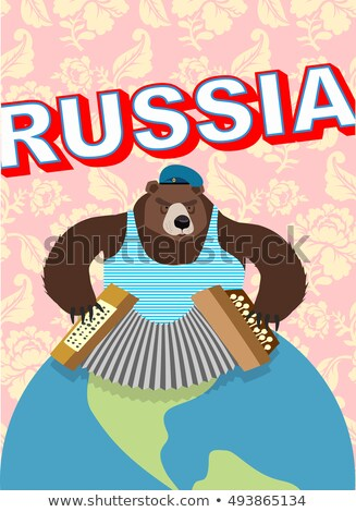 Russian bear in a cap with earflaps plays the harmonica Stock photo © orensila
