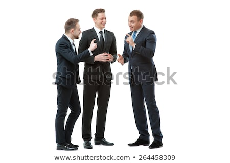 Full length portrait of a friendly businesspeople standing together in office Stock photo © deandrobot