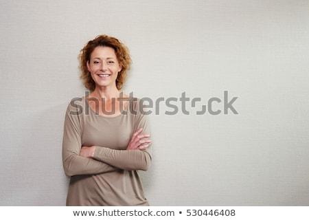 Beautiful happy adult woman styling hair stock photo © lubavnel