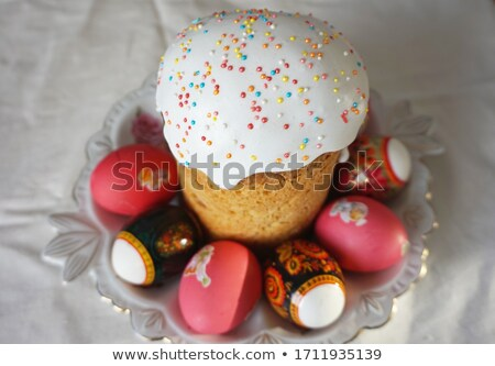 Easter table with sweet eggs, pink roses and fresh cakes Stock photo © Julietphotography