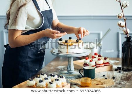 szakács · óvatosan · sivatag · konyha · háttér · tányér - stock fotó © dotshock