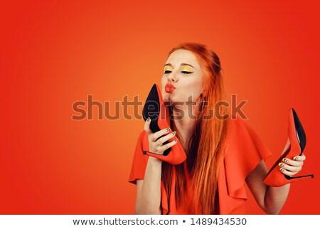 Woman kissing high heel shoe Stock photo © photosebia