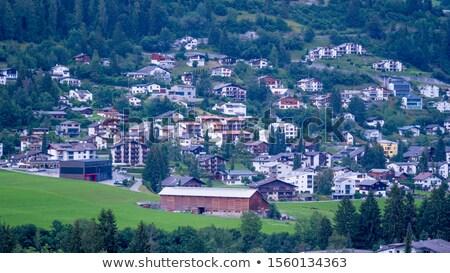 Berg Zwitserland klein alpen huis wolken Stockfoto © romitasromala