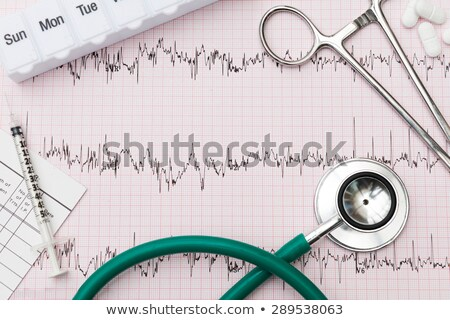 Medical Equipment Arranged On Pulse Trace Printout Stock photo © HighwayStarz