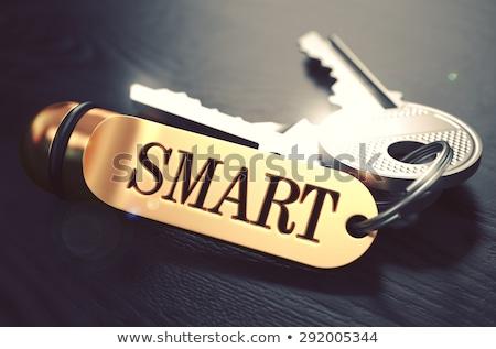 Smart - Bunch of Keys with Text on Golden Keychain. Stock photo © tashatuvango