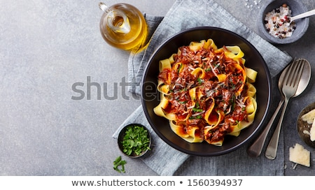 meat with vegetables and pasta stock photo © yelenayemchuk