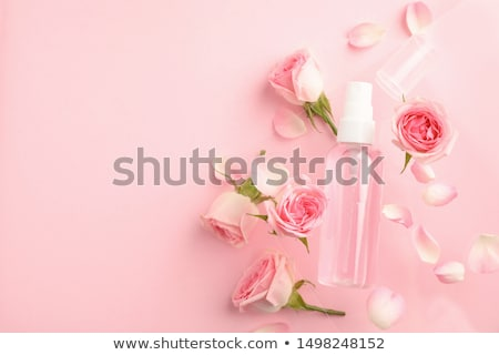 Bottle with rose scented water Stock photo © GeniusKp
