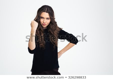 Portriat of a young girl showing fist  Stock photo © deandrobot