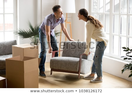 Stock photo: couple carrying a chair