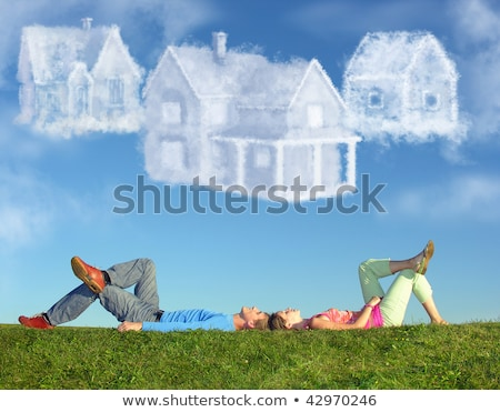 Stock photo: Lying Couple On Grass And Dream Three Cloud Houses Collage