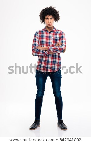 serious afro amerian man standing with arms folded stock photo © deandrobot