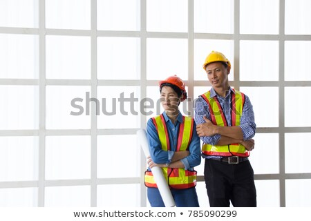 Two male construction twin workers smiling at a building site Stock photo © zurijeta