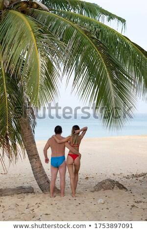 bikini woman standing on perfect white sand beach stock photo © maridav