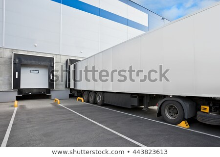 Truck while loading in a big distribution warehouse Stock photo © nasonov