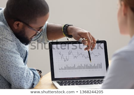 Modern Laptop with Financial report on screen Stock photo © Customdesigner