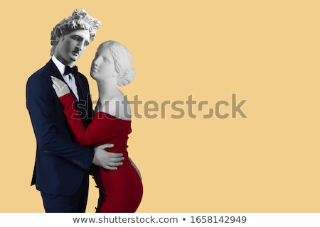 Conceptual portrait of a young couple in elegant evening dresses Stock photo © konradbak