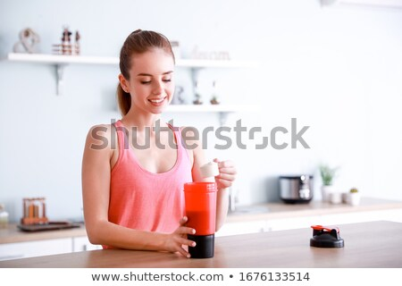 young woman making protein cocktail stock photo © rastudio