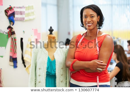 Woman working with mannequin Stock photo © dash