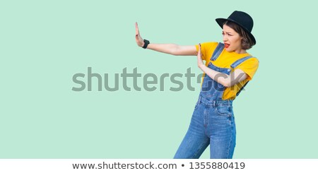 Side profile of woman with stop hand gesture  Stock photo © ichiosea