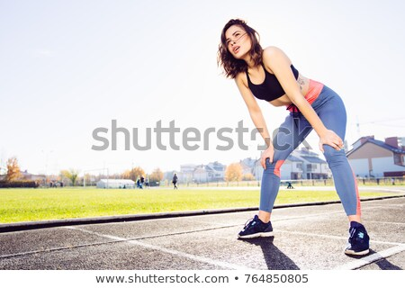 Young caucasian woman taking breath after jogging Stock photo © chesterf